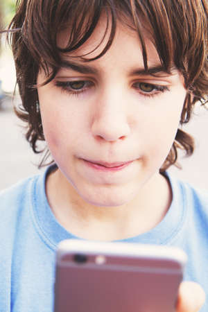 boy with smartphone on street photo