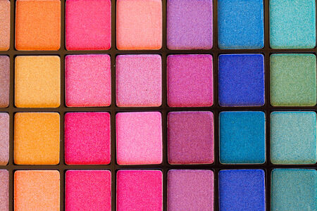 background of colorful blue, pink and green eye shadows palette Stock Photo