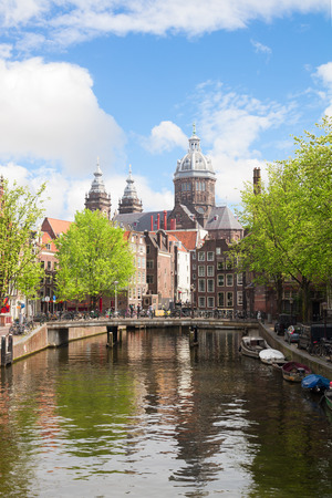 Church of St Nicholas, old town canal, at sunny spring day, Amsterdam, Holland photo