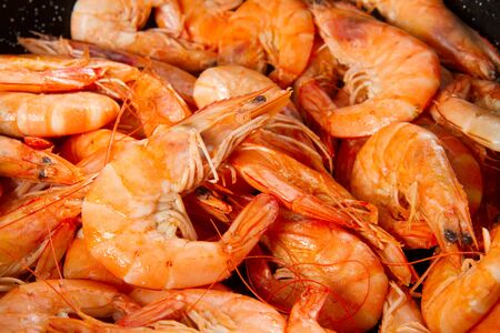 red cooked: pile of big king red cooked  prawns