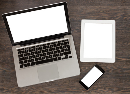 set of modern computer devices  - laptop, tablet and phone with copy space on screen photo