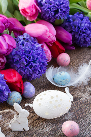 easter eggs and bunny  with fresh tulips and hyacinth photo