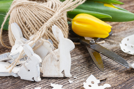white easter rabbits and fresh yellow tulip photo