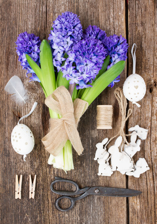 Blue hyacinth  flowers and easter set up photo