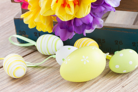 posy: easter eggs and posy  of spring flowers on wooden table Stock Photo