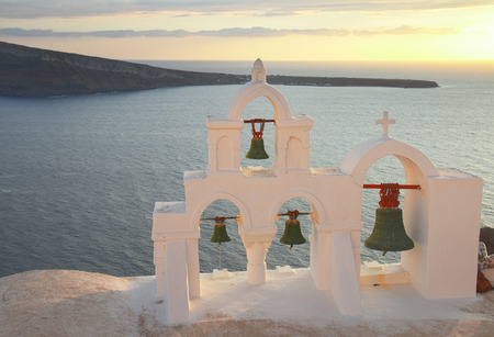 white belfry in Santorini island, Greece Stock Photo