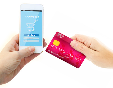 holding credit card: hand holding credit card for payment Stock Photo