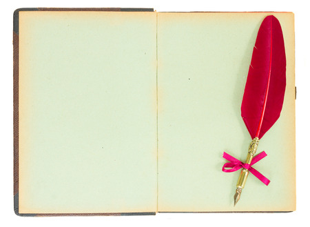 Vintage  open book with pen feather isolated on white background photo