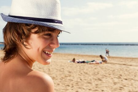 sun lotion: boy with sun lotion on shoulder Stock Photo