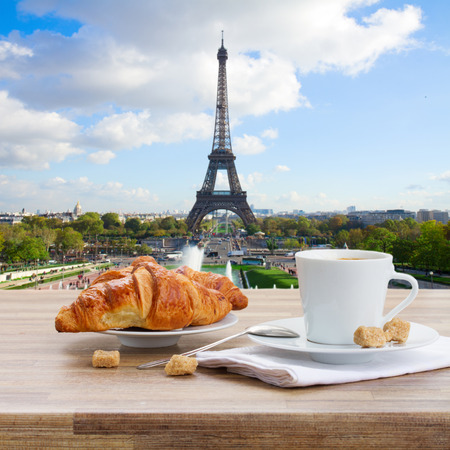 breakfast cup: cup of coffee with croissant in Paris, France