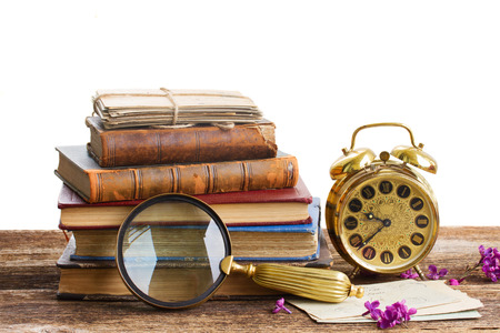 pile of books with clock photo