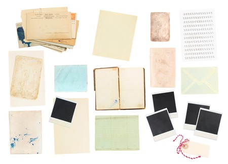 aged aged paper sheets, books, pages and old instant photo  isolated on white background photo
