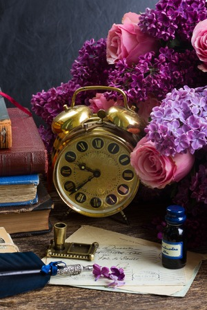 quill pen: antique  clock with pile of mail Stock Photo