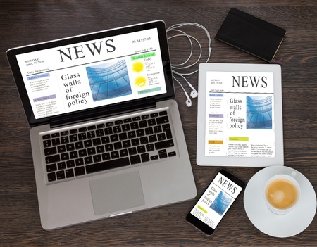 modern computer devices with news site