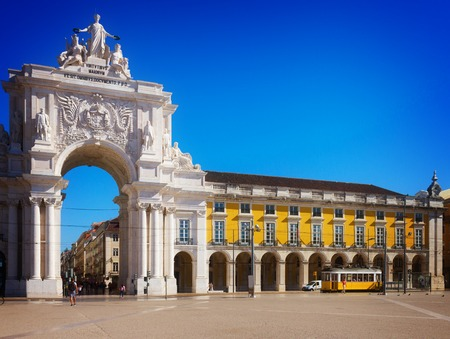 augusta: Rua Augusta Arch is a triumphal arch-like, historical building and visitor attraction in Lisbon on Commerce Square at day., Portugal, toned