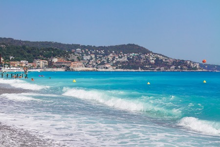 nice france: stone beach and turquiose water of cote dAzur at Nice, France