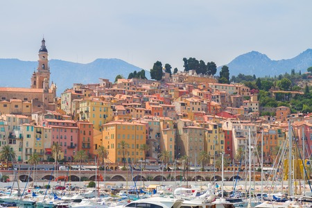 menton: colorful houses of Menton old town embankment, France Stock Photo