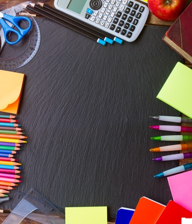 school supplies: Back to school supplies as a frame on blackboard