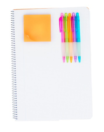 ruled: Ruled notebook with set of pens and orange sticker isolated on white