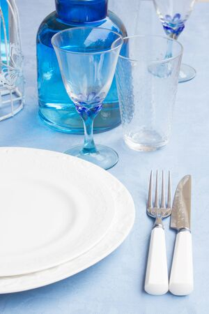 utencils: Tableware - set of plates, cups and utencils close up