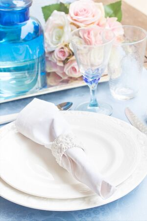 utencils: Tableware - set of plates, cups, utencils and flowers Stock Photo