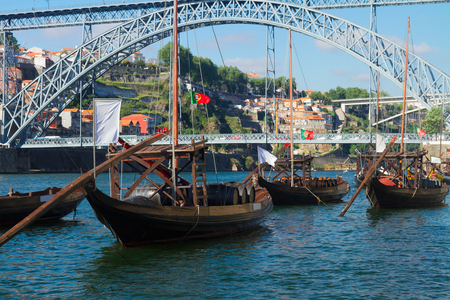 rabelo: traditional  rabelo boats and bridge of Dom Luis I in old Porto, Portugal Stock Photo