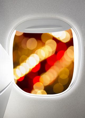 plane window: Plane window with blur of night lights Stock Photo