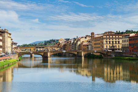 trinita: Ponte Santa Trinita bridge and Ponte Vecchio bridge over the Arno River, Florence, Italy Stock Photo
