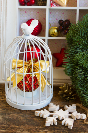 retro christmas decorations with bird cage stock photo 45645386