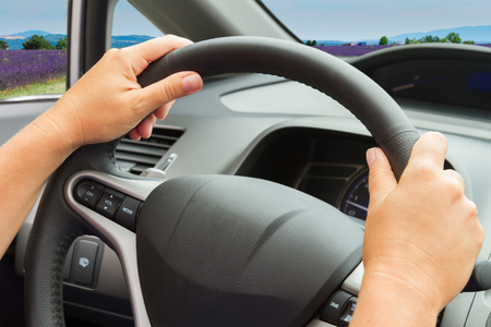inside out: someones hands with steering wheel close up, view  inside out