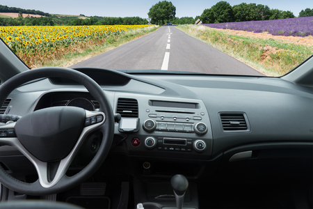 car windscreen with  country road, view  inside out