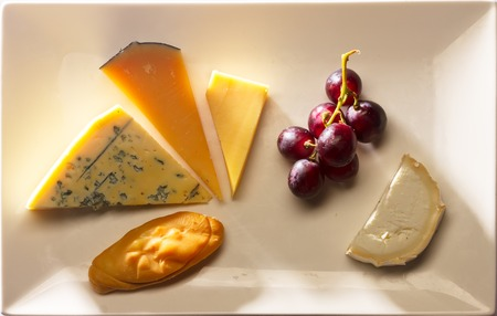 oscypek: cheese plate with cheddar, oscypek, roquefort, old amsterdam and neufchatel cheese