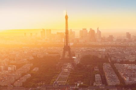 eiffel: Eiffel Tower  and Paris  skyline from above in orange sunset sunlight, France