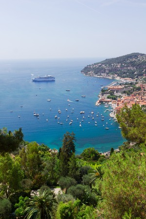 villefranche sur mer: coast with pines and turquiose water of cote dAzur, France Stock Photo