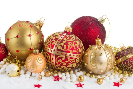 heap of snow: Heap of christmas  balls in gold  and red colors  in snow border  isolated on white background