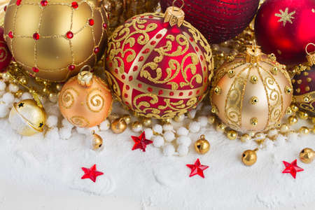 golden ball: pile of christmas red and golden ball  in snow Stock Photo