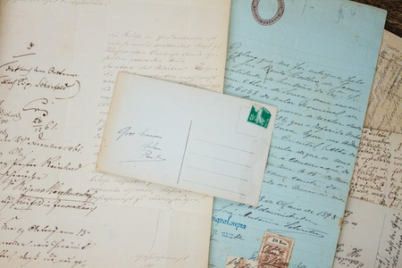 copy sapce: Set of handwritten antique letters close up and copy sapce on empty antique postcard