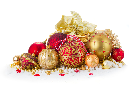 heap of snow: Heap of christmas  balls in gold  and red colors and gift box in snow  isolated on white background Stock Photo