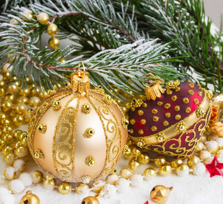 golden ball: christmas red heart and golden ball with evegreen tree  in snow close up