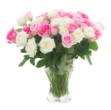roses petals: bouquet of fresh pink and white fresh roses in glass vase isolated on white background