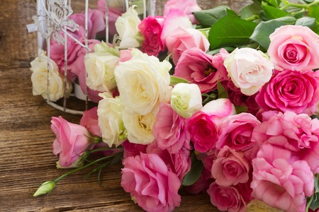romance rose: heap of pink and white fresh roses and eustoma flowers close up