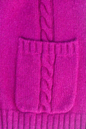 texture of knitted soft mauve sweater background with pocket