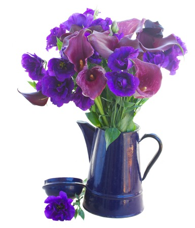 white callas: Calla lilly and eustoma flowers in blue pot isolated on white background