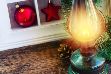 vintage glowing  lantern with  christmas decorations close up, low key