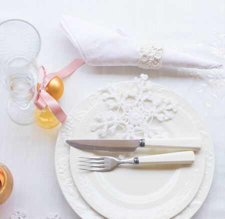 utencils: Tableware for christmas - set of white plates with decorations  and utencils , top view Stock Photo