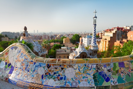 barcelona city: Gaudi bench and cityscape of Barcelona  from park Guell,  Spain