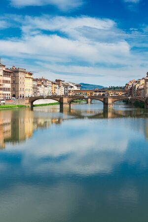 trinita: Ponte Santa Trinita bridge over the Arno River with reflections, Florence, Italy