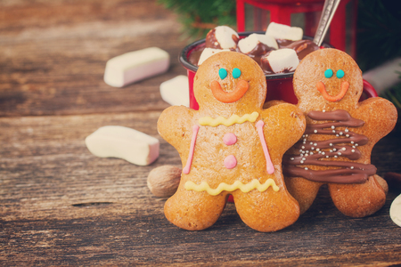 gingerbread cookie: two traditional homemade gingerbread on wooden table, retro toned