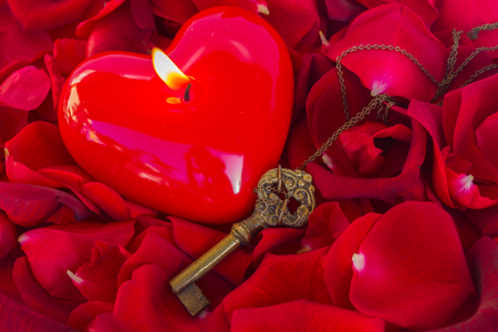 burning love: Key with the burning candle  heart as a symbol of love