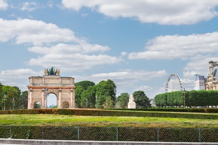 carrousel: view of Arc de Triomphe du Carrousel and  Tuileries Garden at sunny day, Paris, France